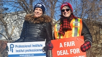 President Debi Daviau picketing with ETFO